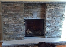 Beaudoin Stonescapes Indoor Veneer Fireplace
